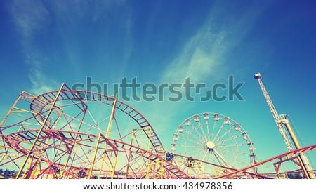 Vintage toned picture of an amusement park. #434978356