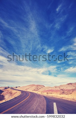 vintage toned road in badlands...