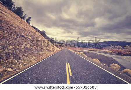 vintage toned scenic road with...