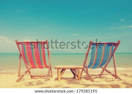 vintage toned two beach chairs...