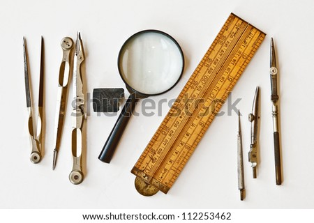 Vintage tools for measurement, drawing, draftsmanship, and graphical works. Isolated on white background.