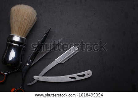 Vintage tools of barber shop on black background