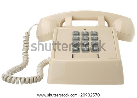 Vintage touch tone telephone isolated on white