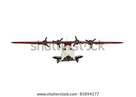 Vintage toy airplane isolated on white.