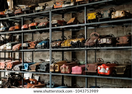 Vintage toy car in museum. Colorful of toy car. Vintage toy car made from steel.  #1043753989