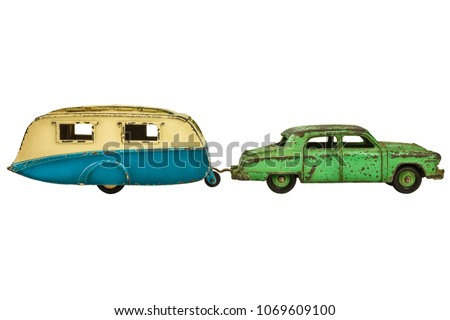 Vintage toy car with classic caravan isolated on a white background