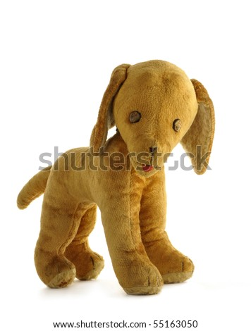 Vintage toy - dog, stuffed with straw, isolated on white background