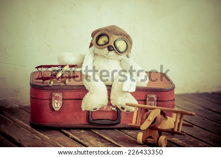 Vintage toys in nursery. Travel and adventure concept. Retro toned