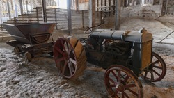 vintage tractor pulling wagon in old abandoned claybank brick factory