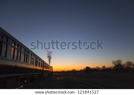 Vintage train going off into the sunset