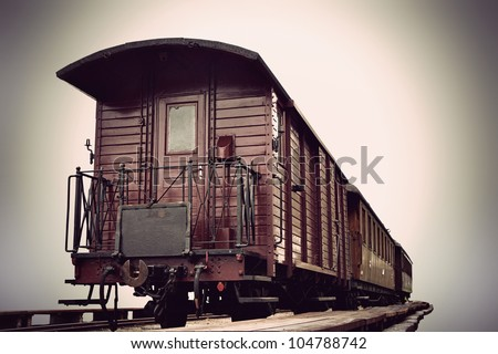 vintage train with wooden cars in sepia tone