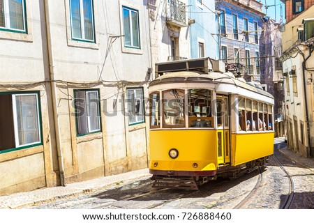 Vintage tram in the city center of Lisbon in a beautiful summer day, Portugal