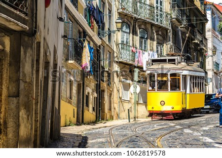 Vintage tram in the city center of Lisbon, Portugal in a summer day #1062819578