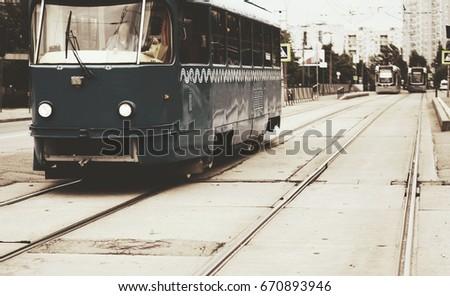 vintage tram rides on the street