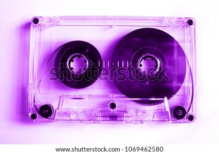 Vintage transparent audio cassette in violet color