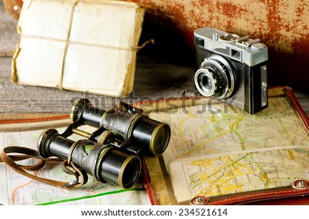 vintage travel memories concept Old camera binoculars letters and map-holder with map