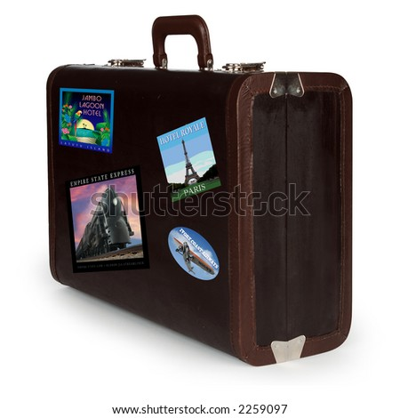 vintage travel suitcase with travel stickers isolated on white with clipping path