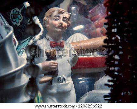 Vintage Turkish Shoemaker Porcelain Miniature Statue With One Arm Missing, Standing At An Antiques Market Display In Istanbul, Holding A Boot In His Hand.
