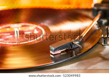 Vintage turntable with a record playing #523049983