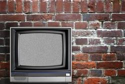 Vintage TV and brick wall