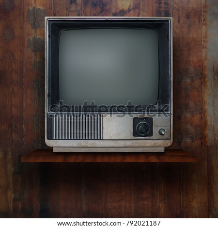 Vintage tv on wood shelf background #792021187
