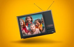 Vintage TV suspended in the air on a yellow background