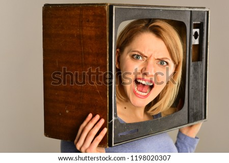 vintage tv. vintage tv in hands of angry girl. tv reporter in vintage style. vintage tv concept. switch television #1198020307