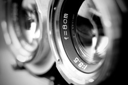 Vintage twin reflex camera lens with shallow depth of field in black and white. Retro style medium format camera lens in blur. Vintage film camera lens.