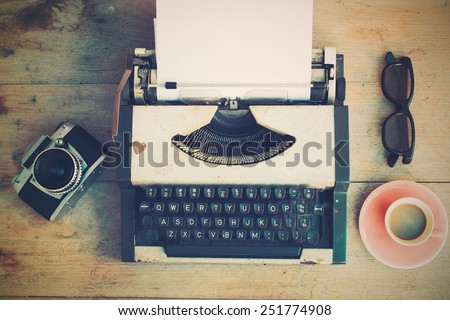 vintage typewriter and vintage camera and coffee on the wood background vintage color tone  - Shutterstock ID 251774908