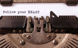 Vintage typewriter close-up - Follow your Heart message