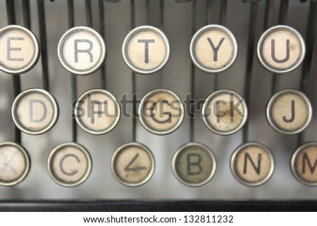 vintage typewriter keys with R, T, Y in focus