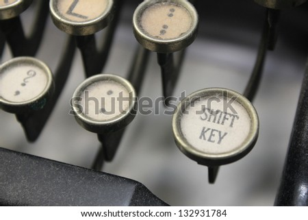 vintage typewriter keys with shift in focus