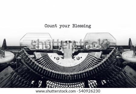 Vintage typewriter on white background with text Count your Blessing. #540926230