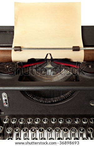 Vintage typewriter with sheet of old blank yellowing paper.