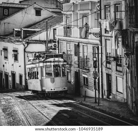 Vintage typical tram in the city center of Lisbon, Portugal (black and white retro).