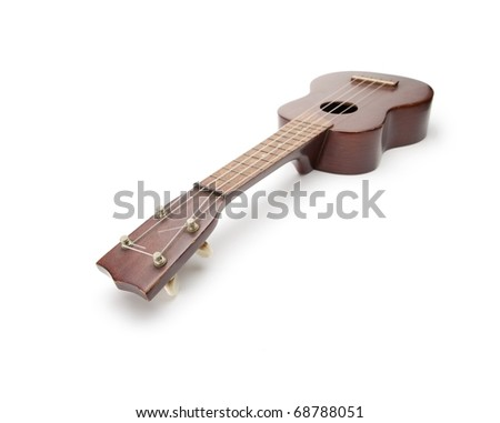 Vintage Ukulele isolated on white.