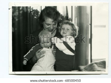 Vintage unretouched photo of young children with their mother