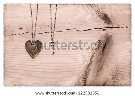 Vintage Valentine,  black and white heart and key on rustic cracked wood for Valentines day background