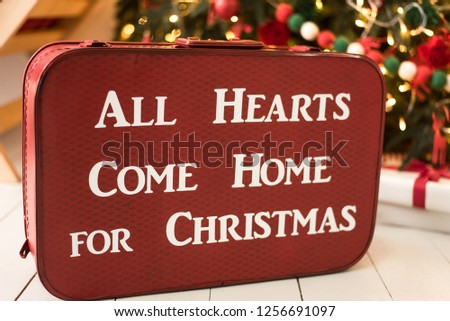 Vintage valise. Chtistmas and New Year decoration. All hearts come home for Christmas. Christmas tree.