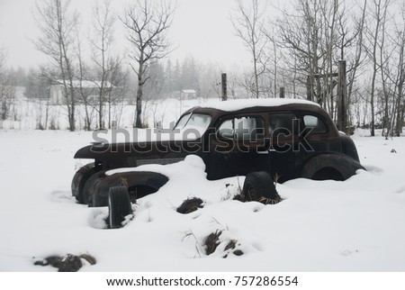 vintage vehicles in snow