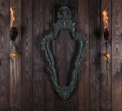 vintage victorian frame on wooden wall
