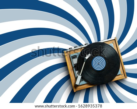 vintage vinyl record player with plate on colorful background with radial lines pattern in trendy classic blue colors. 2020 modern concept dj turntable