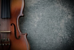 vintage violin on concrete background