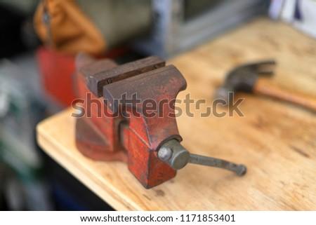 Vintage vise on workbench - Shutterstock ID 1171853401