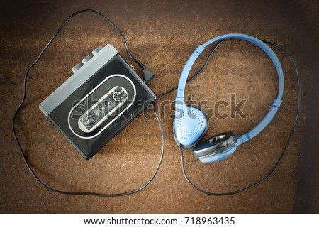 Photo of  Vintage walkman and headphones on the wooden background