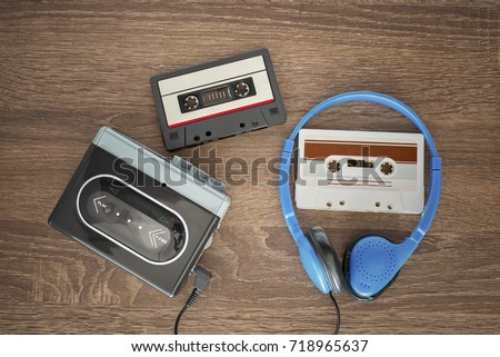 Photo of  Vintage walkman, cassete and headphones on the wooden background