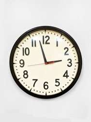 Vintage wall clock isolated on the white background