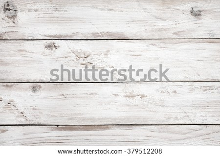 Vintage weathered shabby white painted wood texture as background.