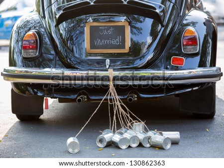 Vintage wedding car with just married sign and cans attached Stockfoto ©