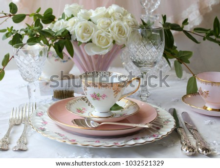 Vintage Wedding Table Setting - dinner plate, salad plate, silver cutlery flatware, pink tea cup and saucer, crystal wine glass, vases white roses, high tea party